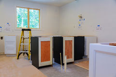 Custom kitchen cabinets in various stages of installation Royalty Free Stock Photography