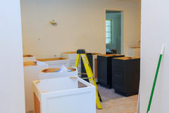 Custom kitchen cabinets in various stages of installation Stock Photography