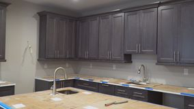 Custom kitchen cabinets in various stages of installation base for of kitchen cabinets
