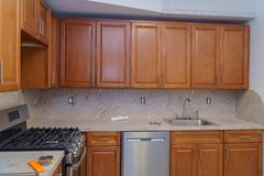Custom kitchen in various of installation base cabinets. Kitchen remodel royalty free stock photo