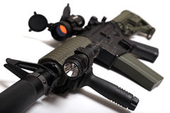 Custom build M4A1 assault rifle. Modern weapon. US Spec Ops M4A1 custom build rifle with red dot sight, silencer and tactical flashlight. Object is on white Stock Photo