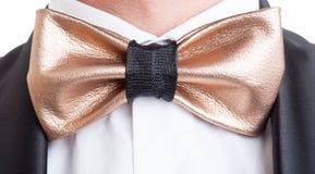Custom made elegant golden leather bow tie Royalty Free Stock Photos