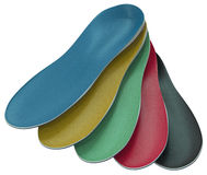 Custom made shoe inserts. Orthotics - custom made shoe inserts isolated on white Royalty Free Stock Photo