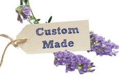 Custom Made. Word written on a Looking card with flower royalty free stock image