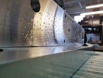 Custom metal part manufactured in milling machine stock photos