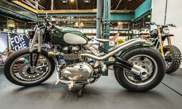 Custom motorbike. Custom triumph motorbike at bikeshed London royalty free stock photo