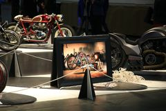 Custom motorcycle in a big photo frame among custom motorcycles in reality stock photos