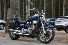 Custom motorcycle Kawasaki Vulcan VN 1500 blue outdoors on a cloudy day. Right side royalty free stock images