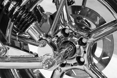 Custom motorcycle wheel. Front wheel of high power big custom motorcycle with chrome parts - monochrome, blurred selective focus Stock Photos
