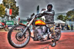 Custom painted American Harley Davidson motorcycle. Custom painted Harley Davidson Motorcycle and rider at Moto Expo a bike show held in Melbourne, Australia stock photography