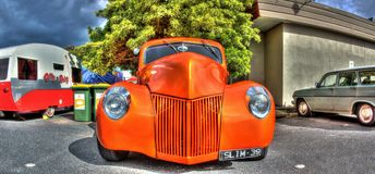 Custom painted 1930s American Ford. Custom painted 1930s orange American Ford on display at car show in Melbourne, Australia Royalty Free Stock Images