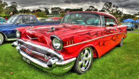 Custom painted 1950s Chevy. Custom painted 1950s red Chevy with flames on display at the Shannon's All American car show held at the Flemimgton race course in Royalty Free Stock Images