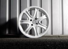 Custom racing car wheel on the asphalt at night isolated Stock Photo