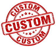 Custom red grunge round vintage stamp. Custom red grunge round vintage rubber stamp Stock Images