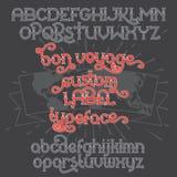 Custom retro typeface Bon Voyage. Vintage alphabet font set on the dark background and world map ribbon scroll Stock Image