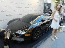 Custom Rides 1500hp Bugatti Veyron with model girl and - Montreal Formula 1 - weekend 2013 Stock Photos