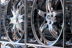 Custom Rims. A row of custom rims and hubcaps lined up neatly on the shelves on display Royalty Free Stock Images