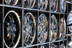 Custom Rims. Rows of custom rims and hubcaps lined up neatly on the shelves on display Stock Image