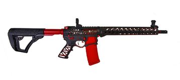 Custom skeletonized AR15 rifle with a black finish and crimson accents HDR. Isolated on a white background, a skeletonized AR15 rifle with a nice black finish stock photo