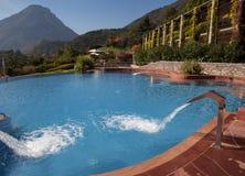 Custom swimming pool and vine covered resort Stock Photo