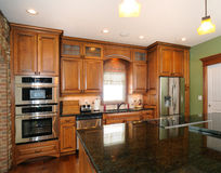 Custom upscale kitchen cabinets. A custon kitchen with highend cabinetry Stock Image