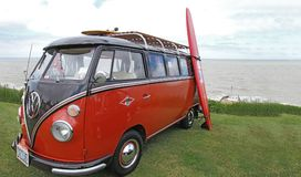 Custom VW Van. A custom VW Van at Whitstable classic car show June 2013, with a surf board on the side and a skate board on roof rack. Ideal picture for car Royalty Free Stock Photo