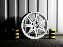 Custom white wheel demounted from sport car Stock Photos