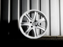Custom white wheel demounted from sport car Stock Images