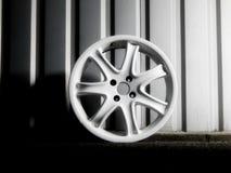 Custom white wheel demounted from sport car Stock Images