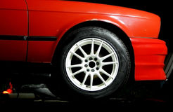 Custom white wheel mounted on sport car Royalty Free Stock Photography