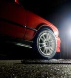 Custom white wheel mounted on sport car Stock Photos