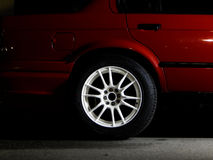 Custom white wheel mounted on sport car Royalty Free Stock Photos