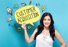 Customer Acquisition with woman holding a speech bubble. Customer Acquisition with young woman holding a speech bubble stock photography