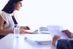 Customer and agent sitting at desk in a meeting or successful collaboration under businesspeople on  office. Customer and agent sitting at desk in a meeting or Stock Images