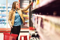 Customer in alcohol or drinks section in supermarket. Stock Image