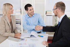 Customer Appointment: Business Team With Client Making Handshake Royalty Free Stock Images