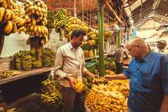 Customer and bananas seller bargain on farmers fruit market Stock Photo
