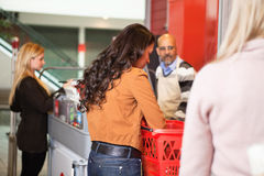 Customer with basket while shopping Stock Images