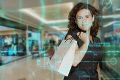 Customer behavior monitoring. Technological screen studying a female shopper stock images