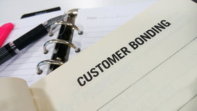 Customer bonding printed on white book. Customer bonding printed on a white book Royalty Free Stock Images