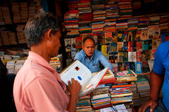 Customer and book trader on the asian street market Stock Images