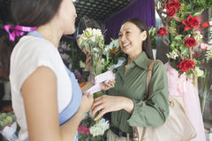 Customer Buying Bunch Of Flowers In Flower Shop Royalty Free Stock Photography