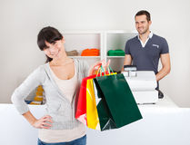 Customer buying clothes in shop Royalty Free Stock Photo