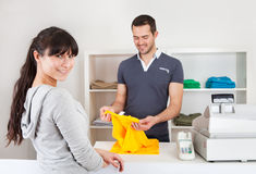 Customer buying clothes in shop Stock Images