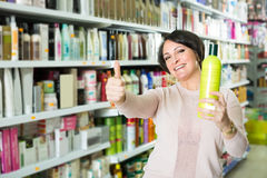 Customer buying conditioner for hair Stock Photo