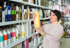 Customer buying conditioner for hair Royalty Free Stock Photo