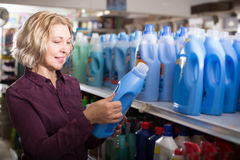 Customer buying detergents. Woman customer buying detergents for laundry in shopping mall Stock Image