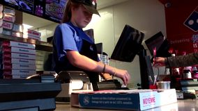 Customer buying Domino pizza and paying by credit card stock video