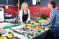 Customer buying fish in shop Royalty Free Stock Image