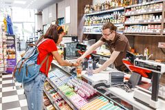 Free Customer Buying Food At Supermarket And Taking Money Change From Cashier Royalty Free Stock Images - 174044899